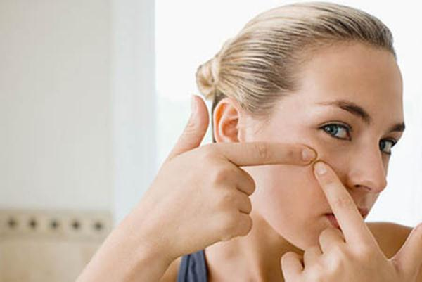 Woman squeezing spot
