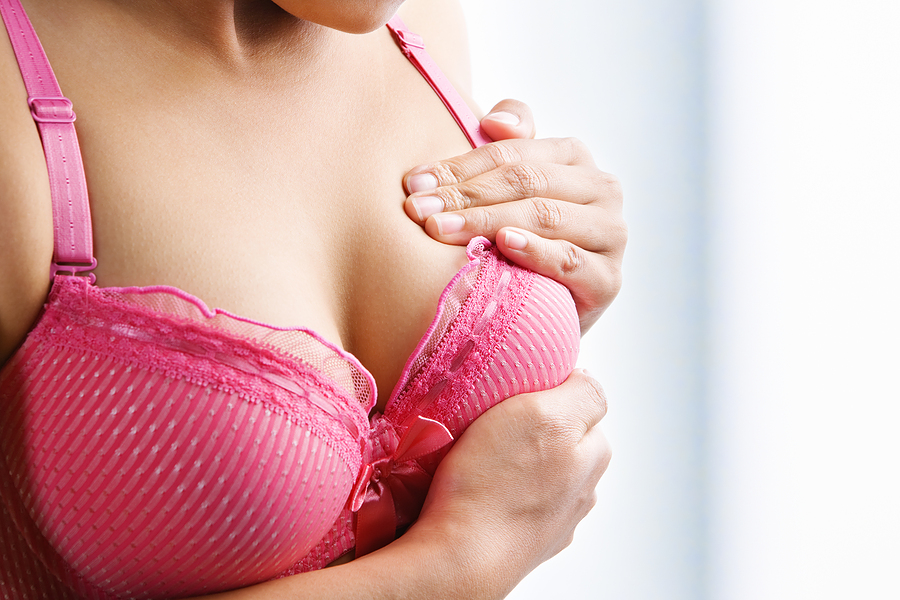 bigstock_Woman_Doing_Self_Breast_Examin_6187599