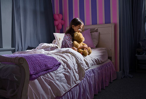 getty_rm_photo_of_little_girl_sitting_awake_at_night_with_worries