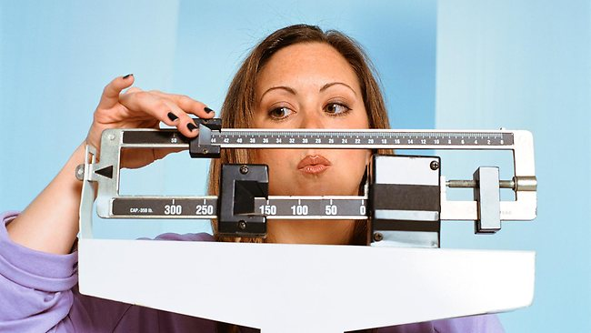 252572-overweight-woman-on-scale