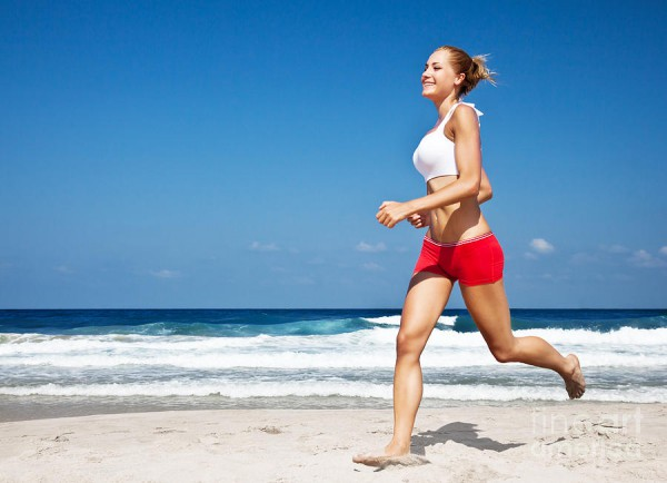 healthy-woman-running-on-the-beach-anna-omelchenko