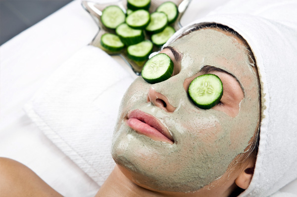 woman-wearing-facial-mask-with-cucumbers