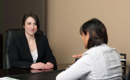 woman_talking_at_desk-2.s600x600