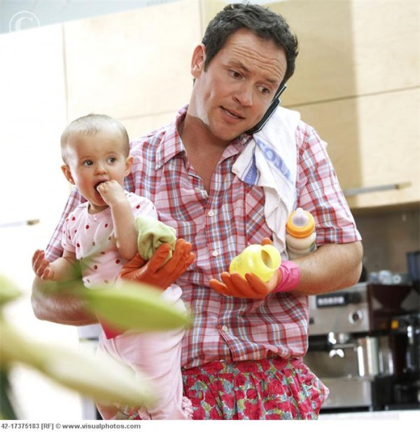 Househusband with Baby Multi-Tasking