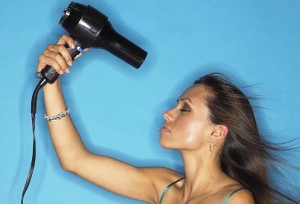 getty_rf_photo_of_woman_using_blow_dryer (Copy)