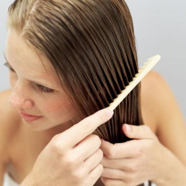 Woman-combing-her-wet-hair