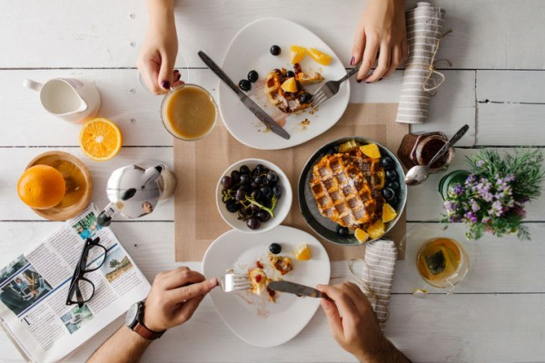 breakfast-couple-waffles-table-meal-coffee-tea-stocksy-w724