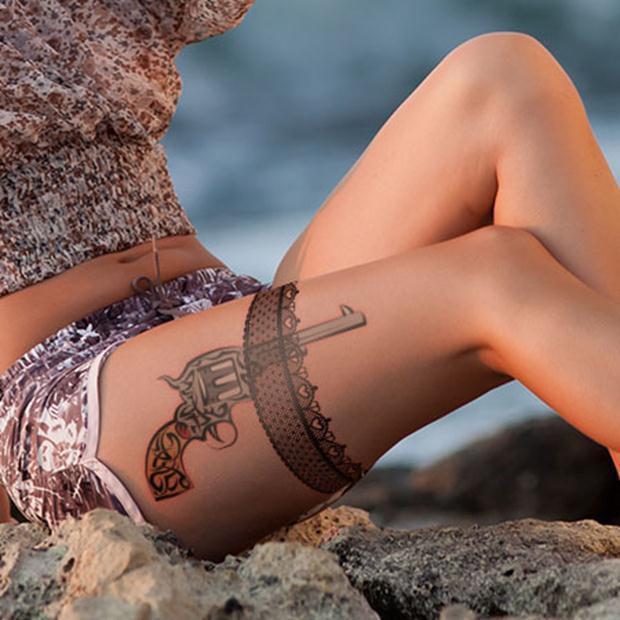 garter-with-gun-lace-tattoo